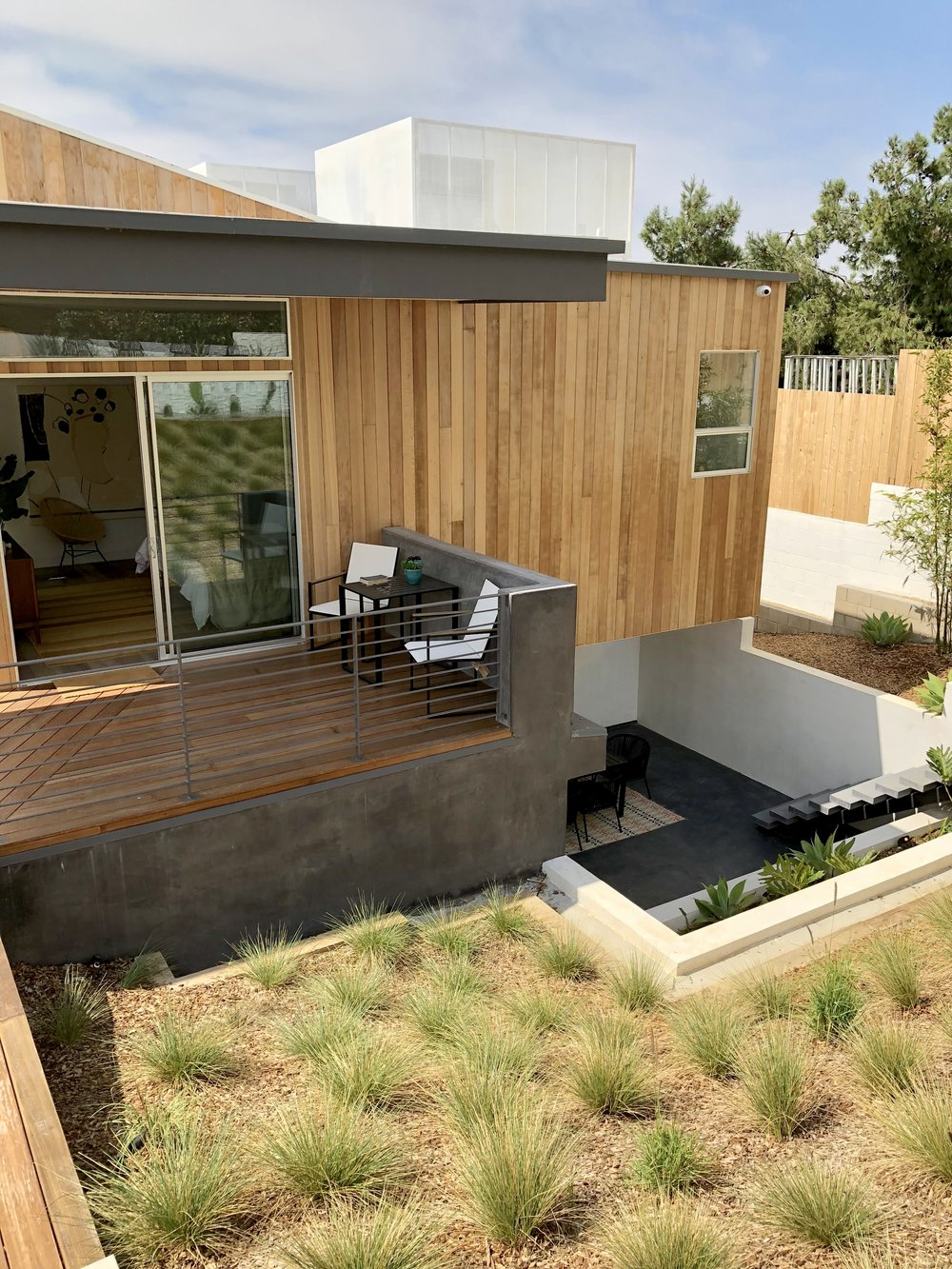 Indoor-Outdoor living with wood decking and various levels of patios | California home tour, Architects: CHA:COL, Inc.