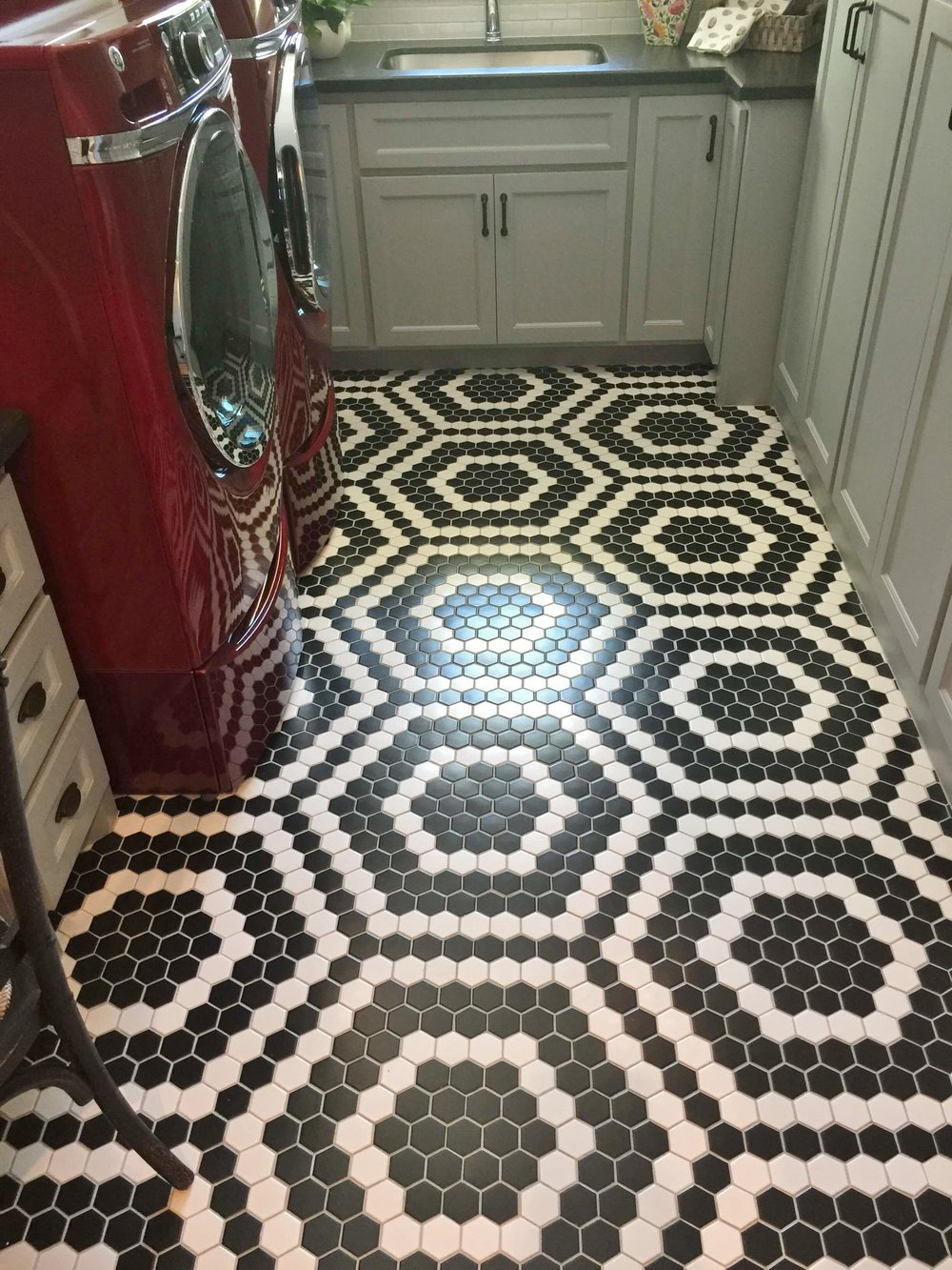 Southern Living Showcase Home - laundry room with red appliances and black and white tile floor #blackandwhite #tilefloor #blackandwhitefloor