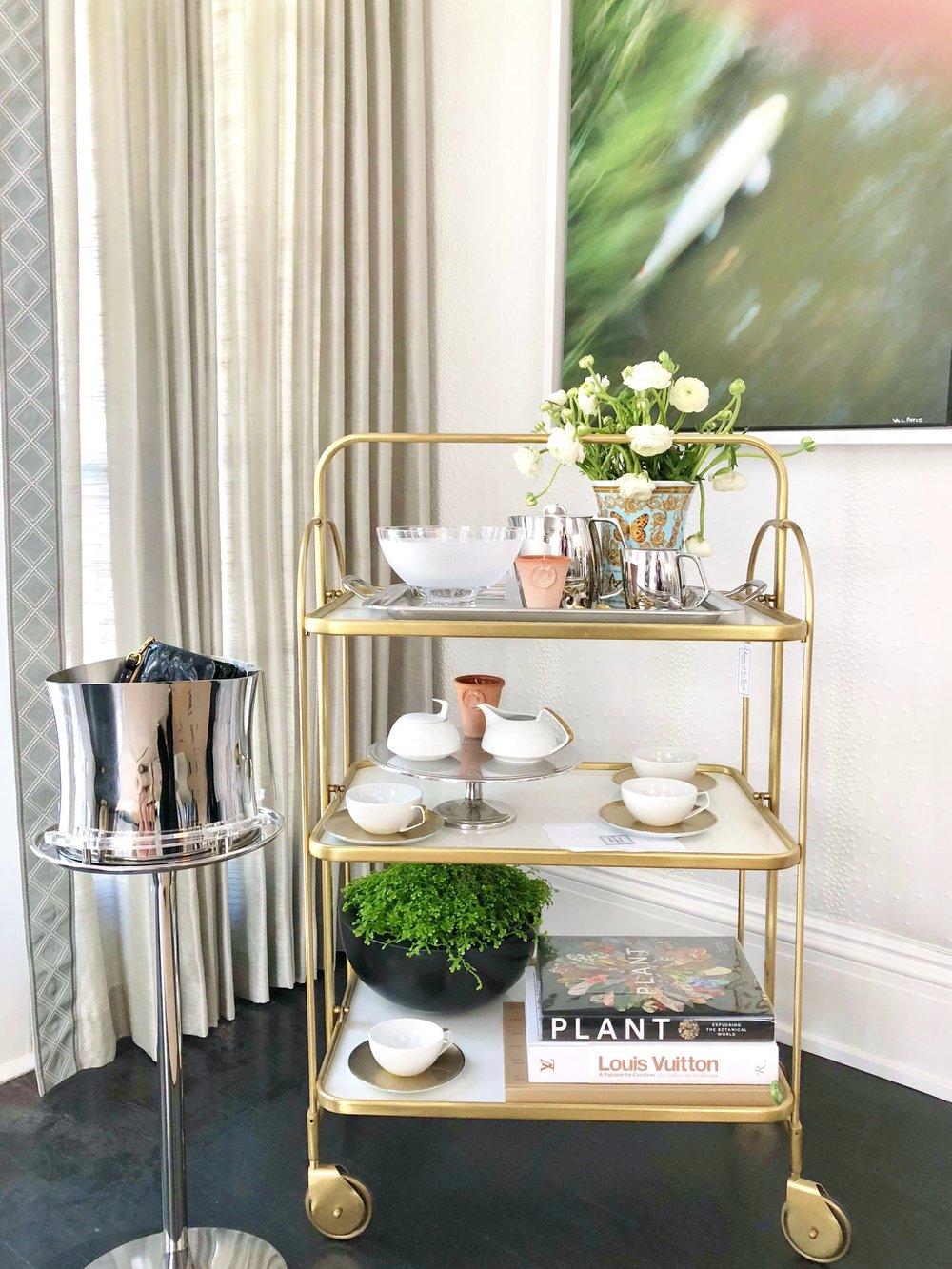 Brass barcart in dining room of Pasadena Showcase House of Design - Designer: Elizabeth Lamont