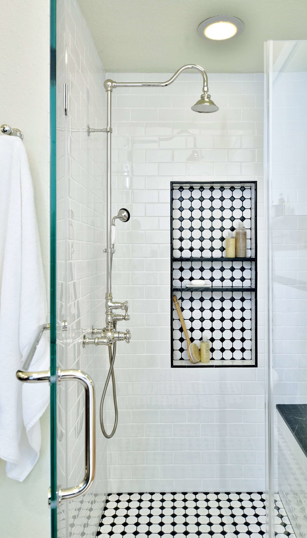 Black and white tile shower with shampoo niche and black marble shelf | Carla Aston, Designer, Miro Dvorscak, Photographer
