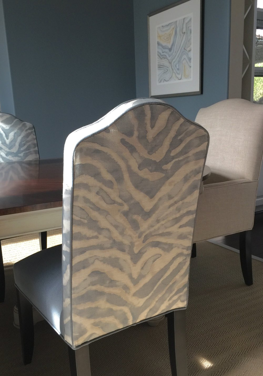 Custom dining chairs with blue zebra print backs in blue dining room | Carla Aston, Designer #zebraprint #diningroomideas