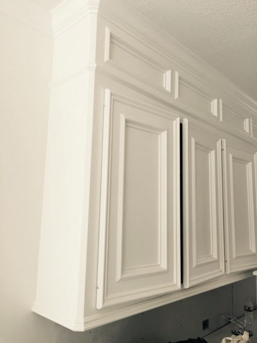 Painted kitchen cabinets with new paneled box above| Interior Designer: Carla Aston