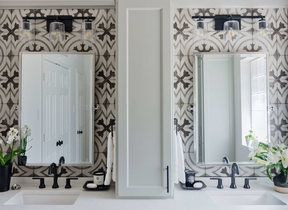 BEFORE AND AFTER - Master bathroom remodel with cement look tile, black faucets and cabinet on top of vanity | Carla Aston, Designer | Charles Behrend, Photographer #cementtile #blackfaucets #doublevanity #bathroomremodel