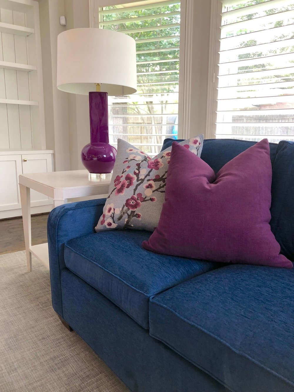 PROJECT SNEAK PEEKS | Colorful sofa, pillows and lamp in living room | Carla Aston, Designer