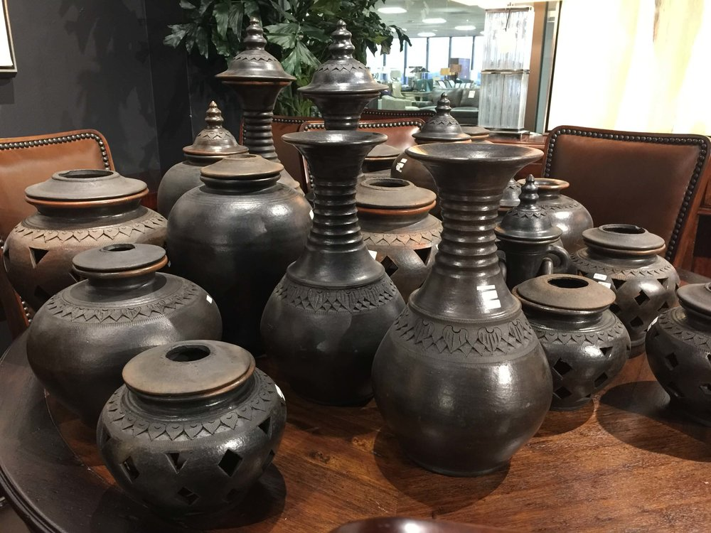 Large hand carved wood vessels seen at Dallas market
