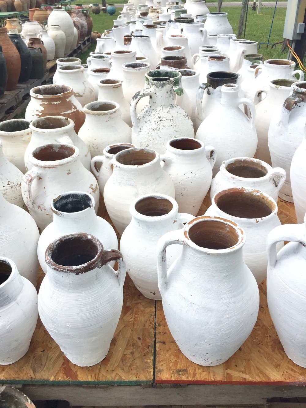 White painted large olive jars at Round Top antique fair