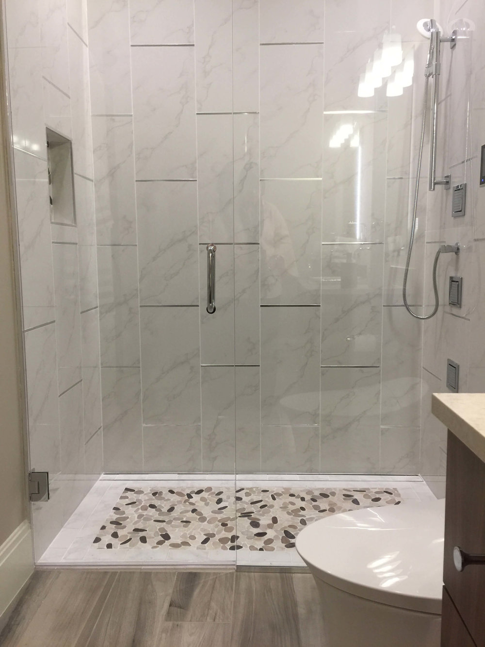 Large shower with no curb from  The New American Home - KBIS2018
