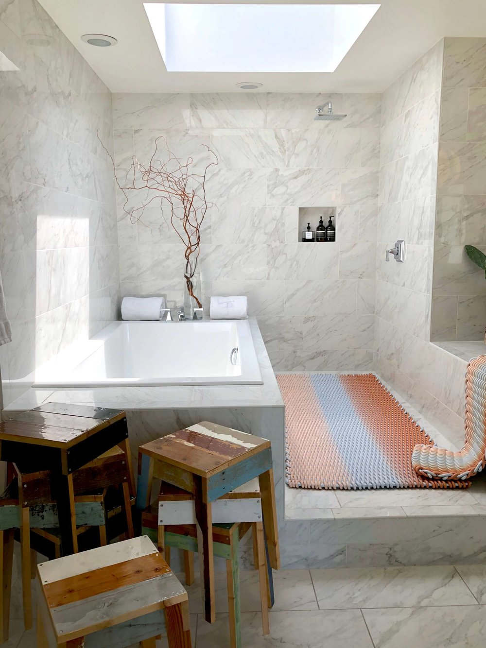 Open shower with adjacent tub at  Casa Perfect on the LA Design Trail
