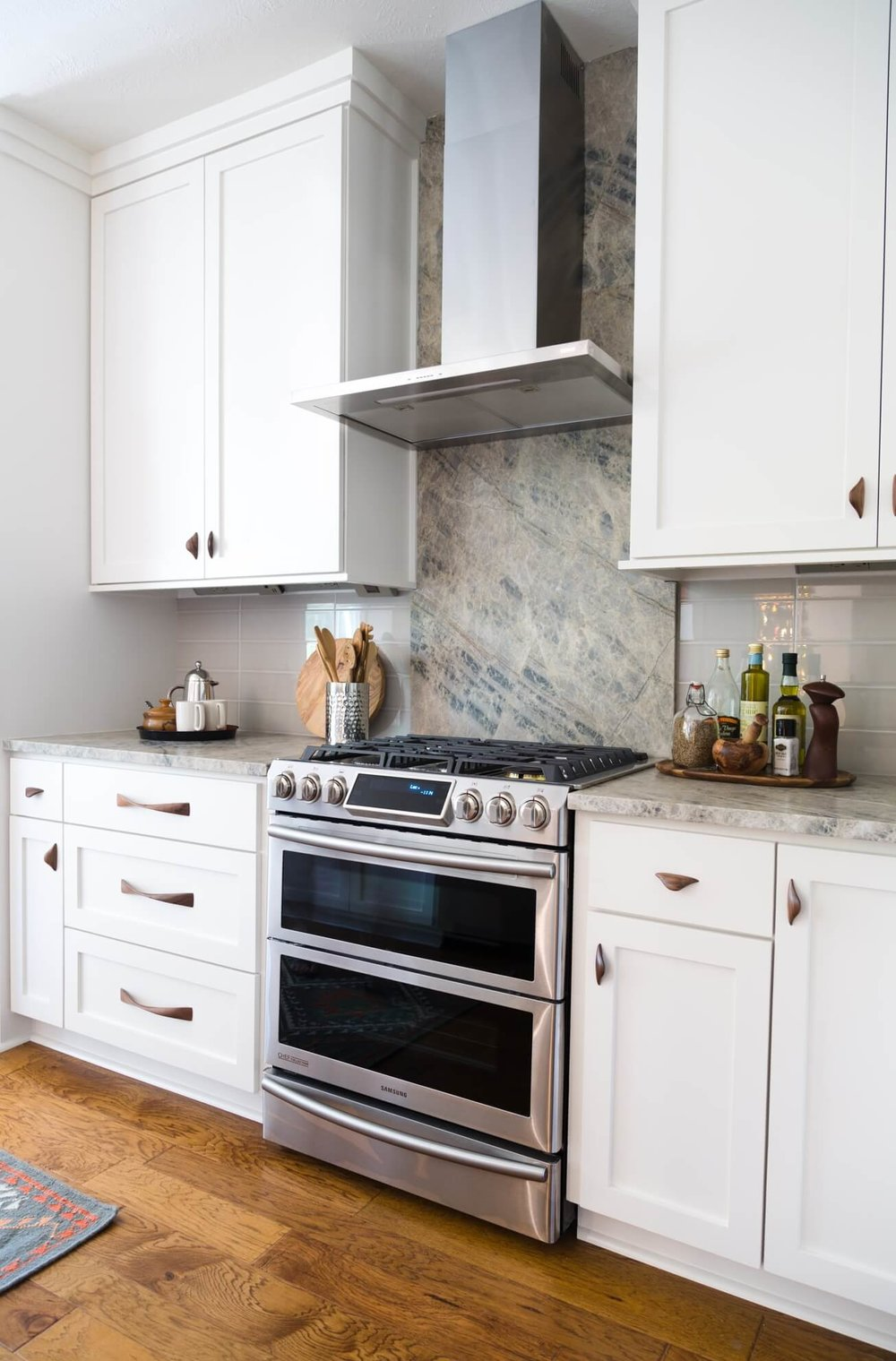 No side backsplash needed here in this  kitchen remodel designed by Carla Aston,  Photographer: Tori Aston