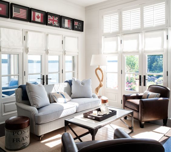 Framed flags hung above set of doors |  Designer: Sharon Mimran