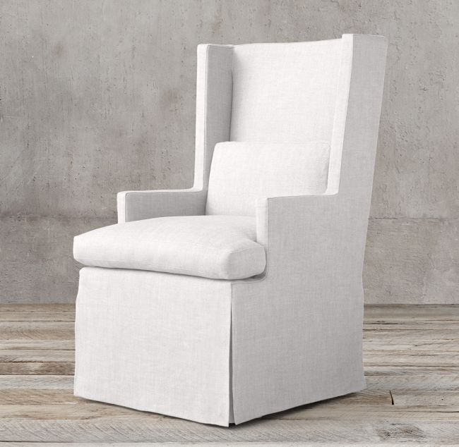 Upholstered white dining chairs in indoor/outdoor fabric