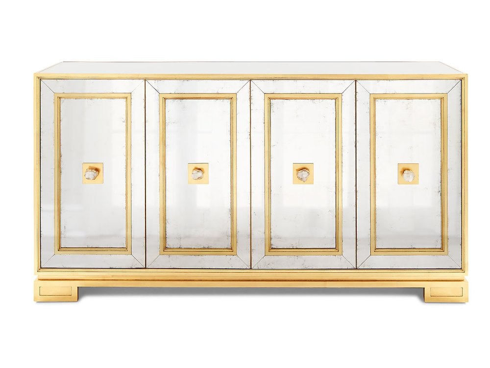 Mirrored console with gilded trim for entry adjacent to dining room