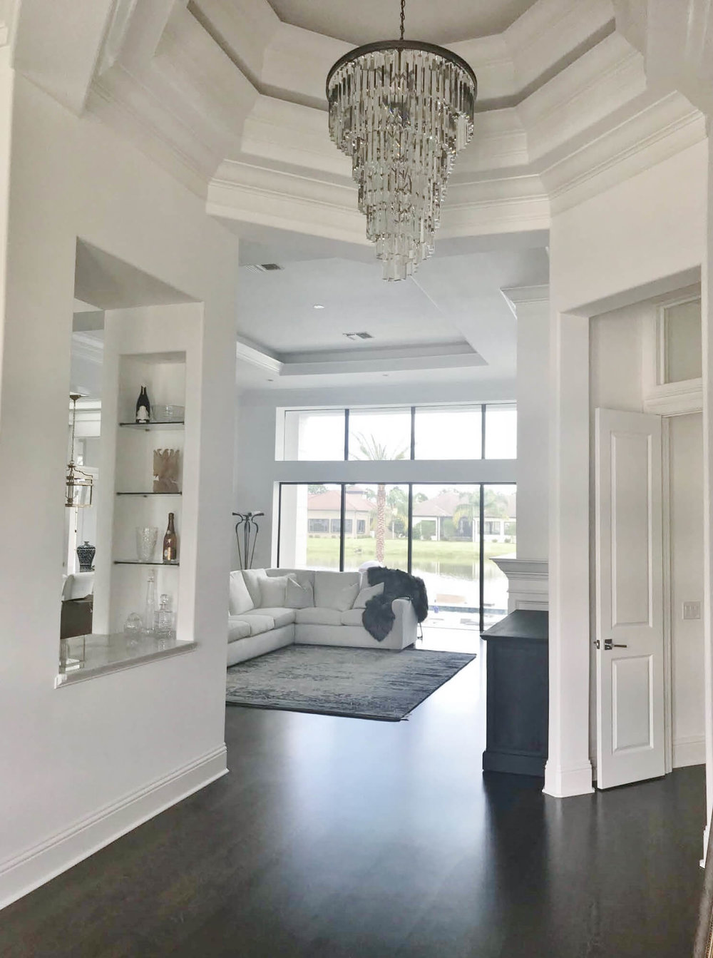A Dining Room Furniture Selection Tweaked With An EDesign Consultation | Entry Hall with Chandelier