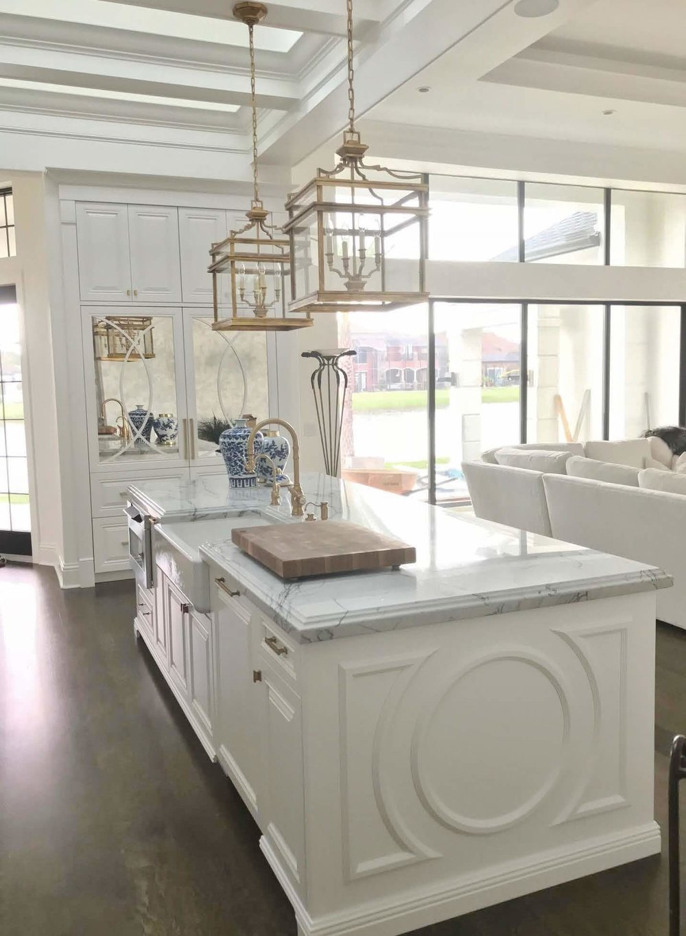 A Dining Room Furniture Selection Tweaked With An EDesign Consultation | Kitchen island with brass lantern pendants
