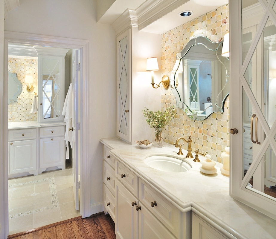 White and brass bathroom makeover with mosaic onyx tile and mirrored front cabinetry | Carla Aston, Designer | Miro Dvorscak, Photographer