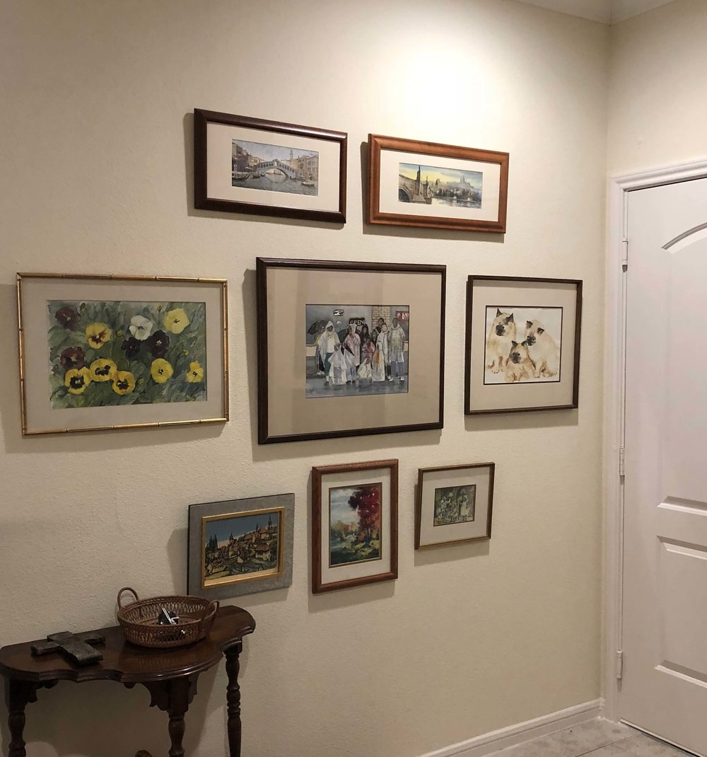 Gallery art wall at the entry of the apartment | Senior retirement living
