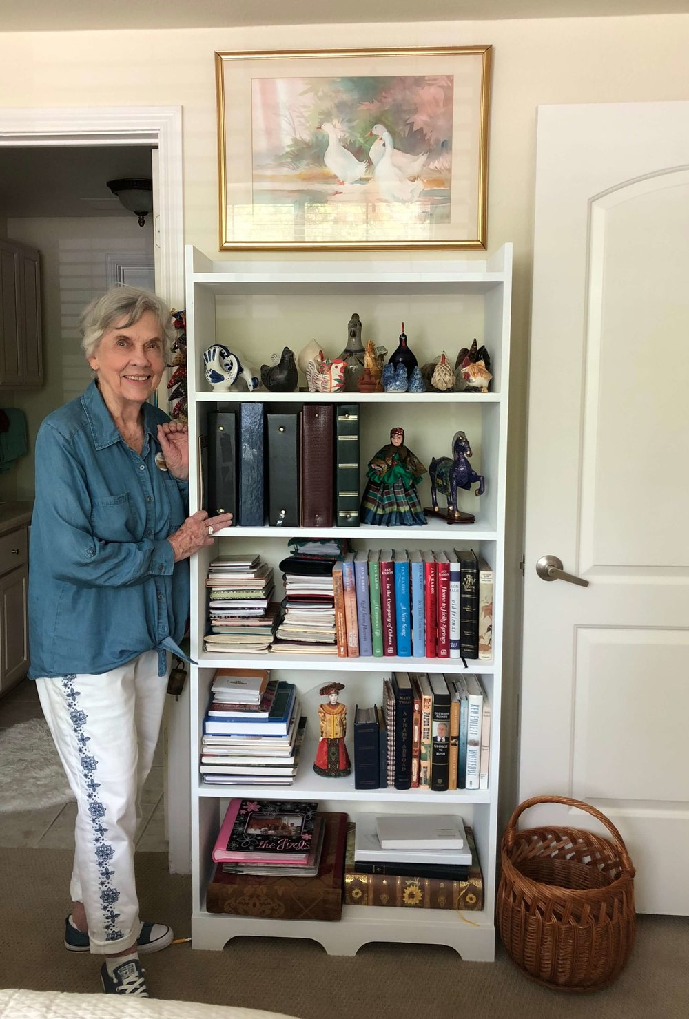 My MIL with the bookcase made for her by a family member to fit this wall space in her new apartment | Senior retirement living