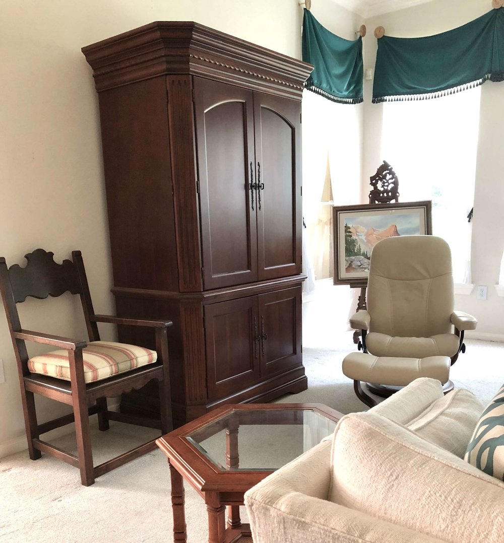 This tv armoire was dated and a bit overpowering for the room. It was removed and the furniture rearranged for a more open and airy feel. #stagedtosell #homestaging #sellingahouse #stagingtosell #stagingideas