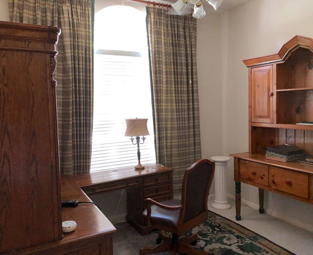 This home office had a lot of big wood furniture. We removed the window treatments and these furniture items and gave it a fresh coat of paint to lighten and brighten the room. #stagedtosell #homestaging #sellingahouse #stagingtosell #stagingideas