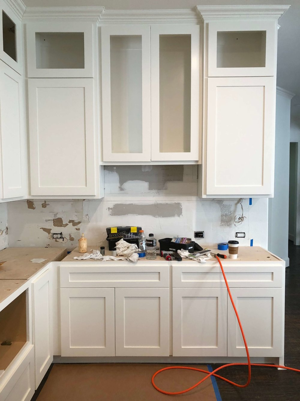 IN PROGRESS - The cabinetry looks fabulous here, crisp and light. Love the cabinets to the ceiling and the absence of the window to the hall. #kitchenremodelideas #whitekitchen #kitchenremodel