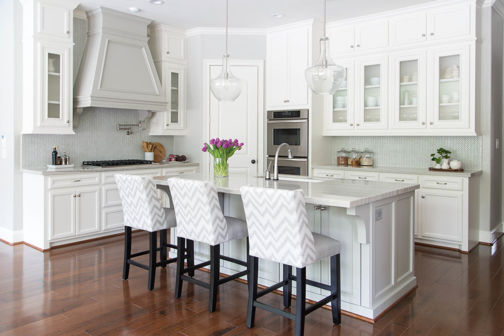 White and gray kitchen with wood floors | Designer: Carla Aston, Photographer: Tori Aston