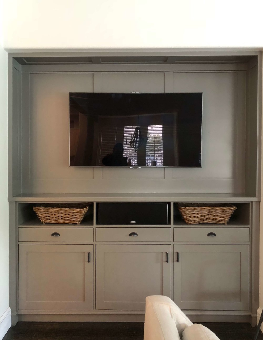AFTER - TV entertainment center built-in cabinet with full height cabinet | Designer: Carla Aston #tvcabinet #entertainmentcenter #builtin #cabinetry