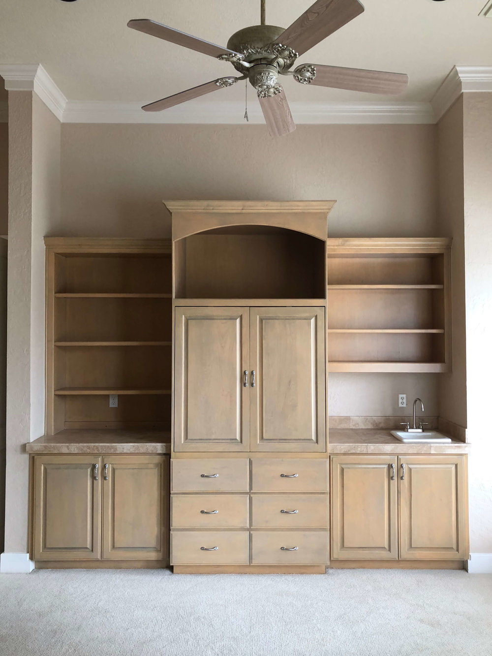 BEFORE - Master bedroom built in cabinetry wall with armoire for older model box style tv