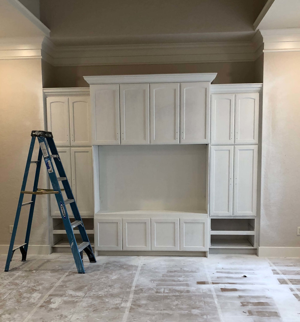Remodel In Progress - Primed cabinetry at family room entertainment center
