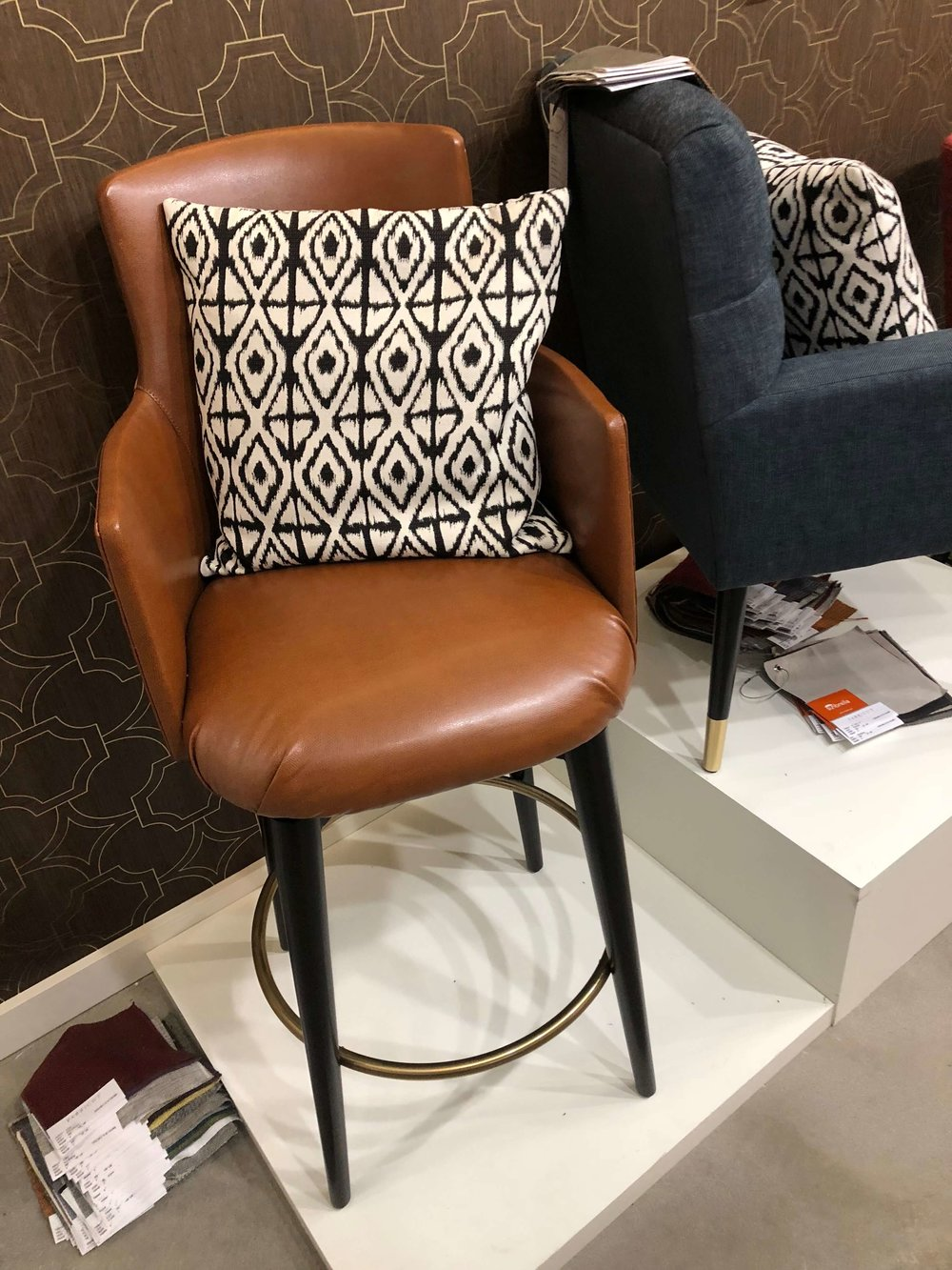 Caramel leather barstool with arms at Fabricut