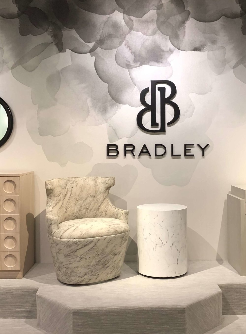 This curvy 80's inspired swivel tub chair was designed by Michelle Bradley for Bradley USA at Highpoint Market