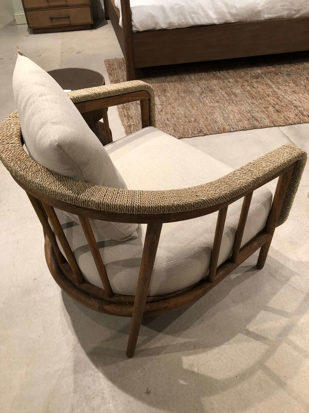Beautiful curved wood framing of this chair at Brownstone Furniture
