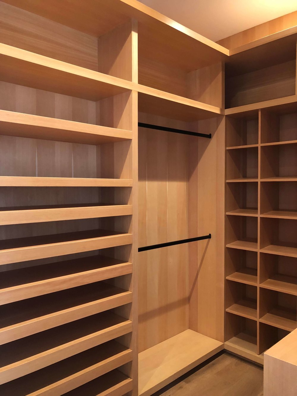 Master closet in natural oak in contemporary home - Dwell on Design's Fall Home Tour, Designer: Vitus Matare #closet #cabinetry #closetdesign