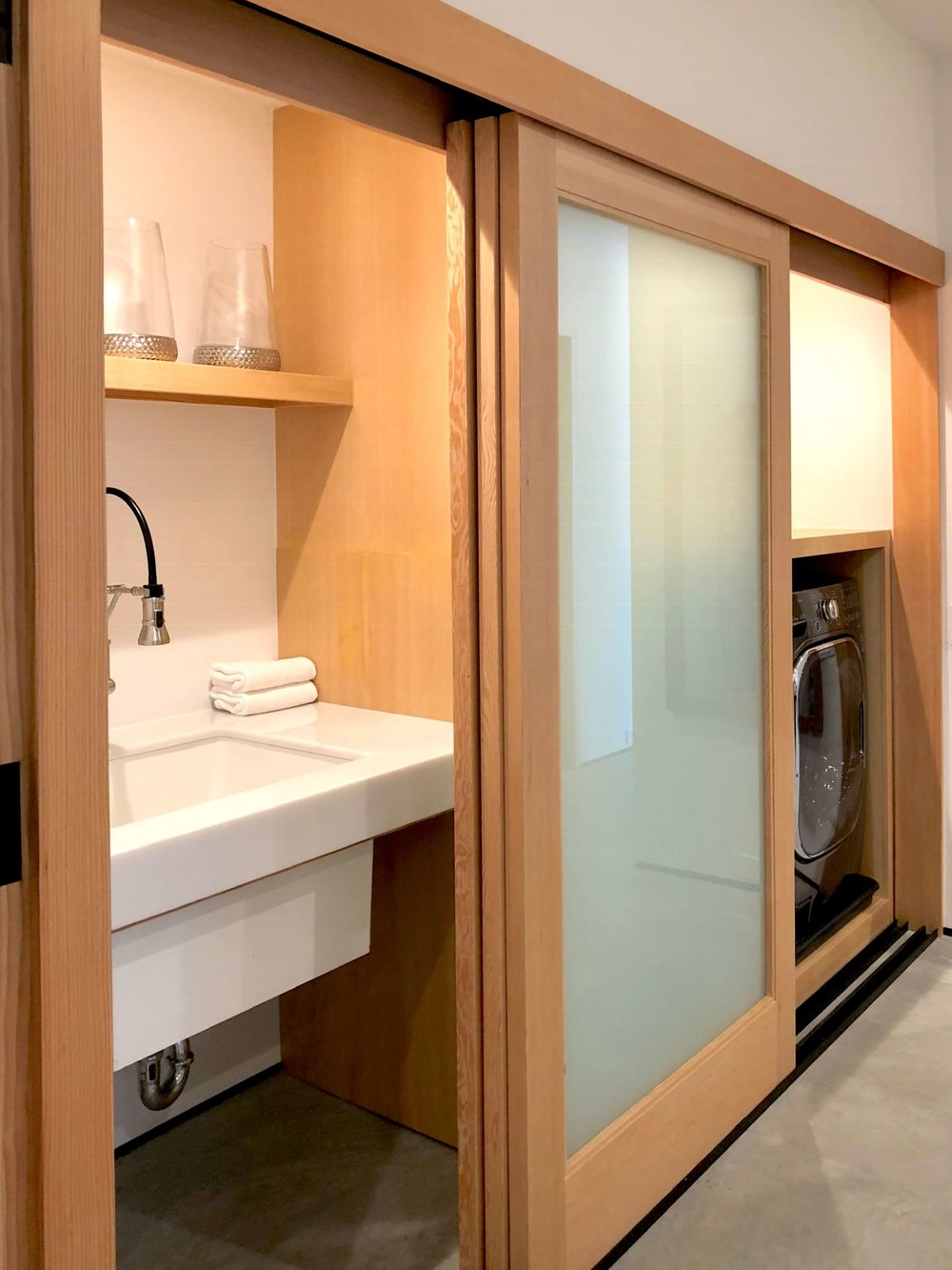 Laundry with wood framed sliding doors in California contemporary home, Dwell on Design's Fall Home Tour, Designer: Vitus Matare #laundryroom #laundryroomideas