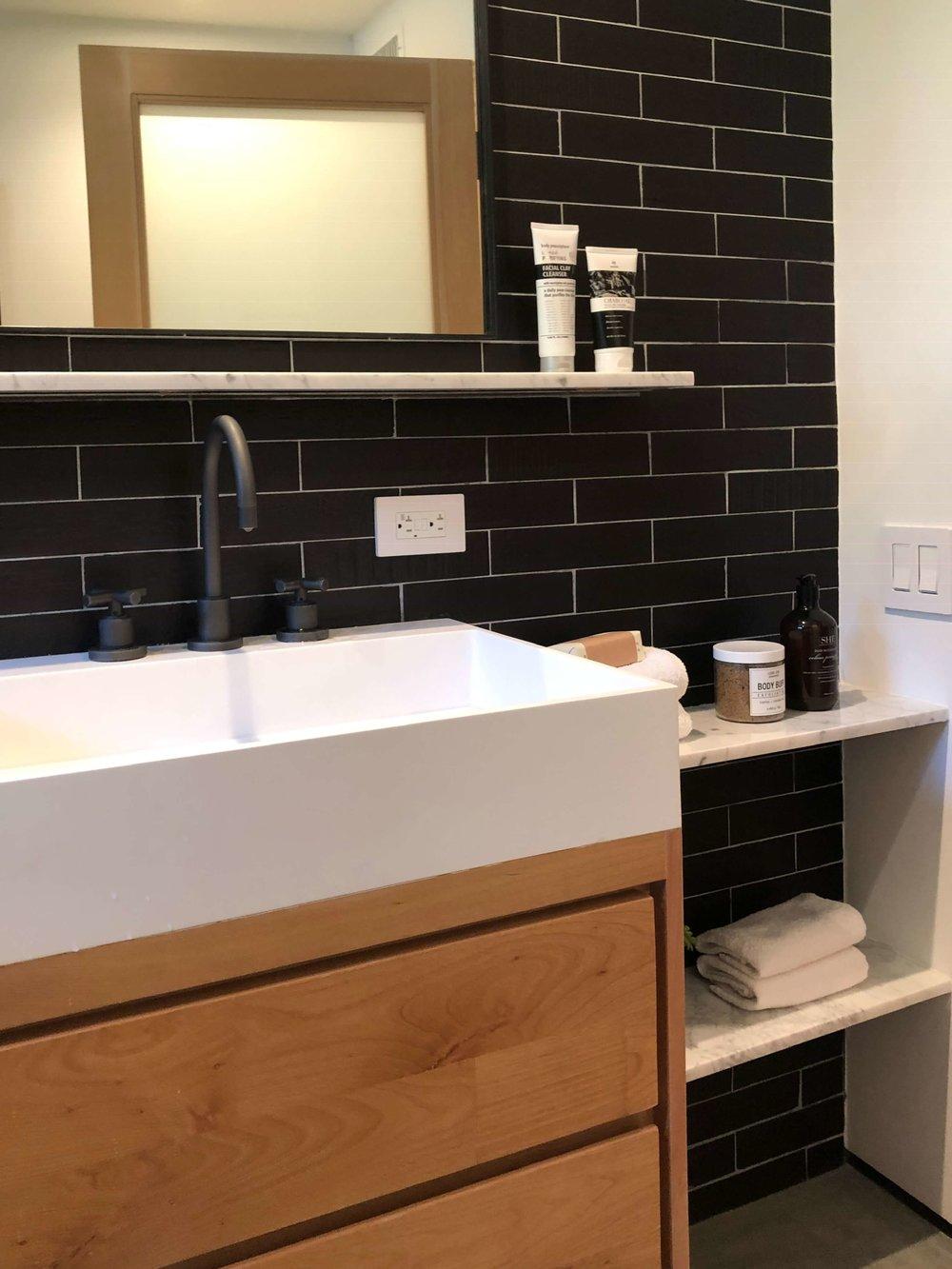 Bathroom vanity in California contemporary home, Dwell on Design's Fall Home Tour, Designer: Vitus Matare #bathroomideas #blacktile