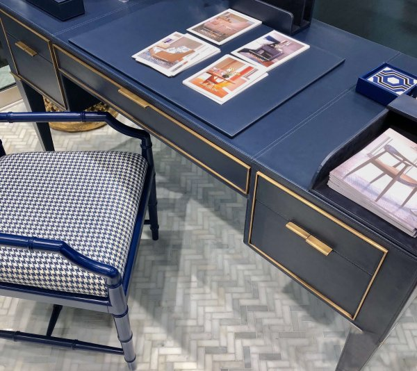 Blue leather wrapped desk with brass trim and pulls from Bungalow 5 | Color Trends From Highpoint Market