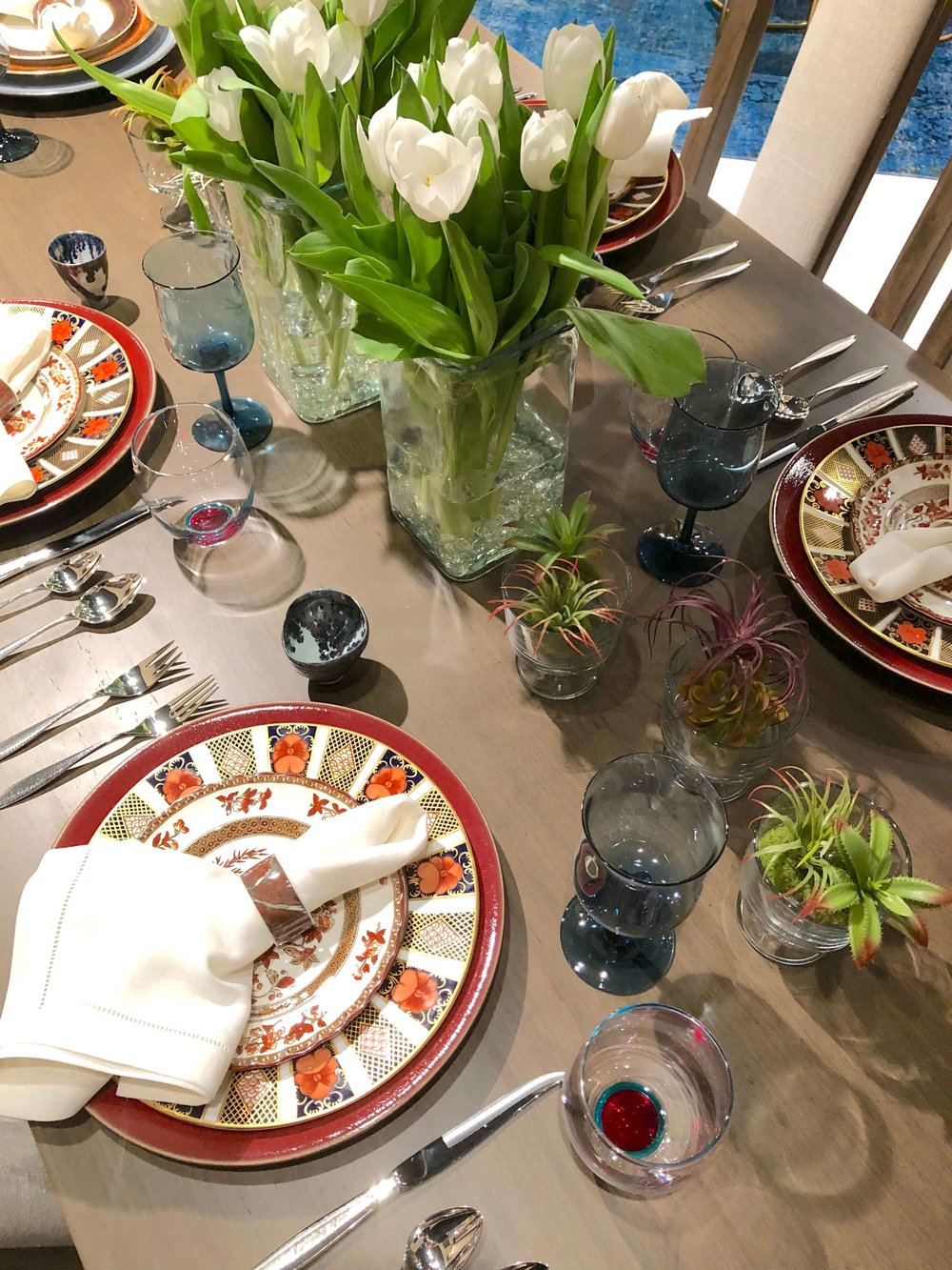 Tulips and succulents as the centerpiece in dining room designed by Jeanne Chung for the Alden Parkes showroom |#floralarrangement #fallflowers #centerpiece #falltabletop #tabletop #tablesetting