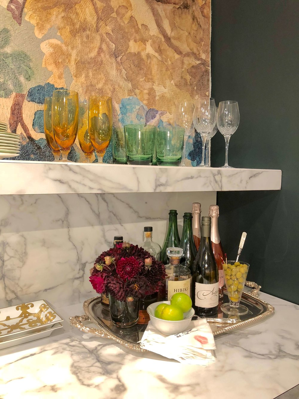 This bar vignette was designed by Jenny Liu for Replacements, Ltd. #bar #silvertray #bardecor #floralarrangement #fallflowers