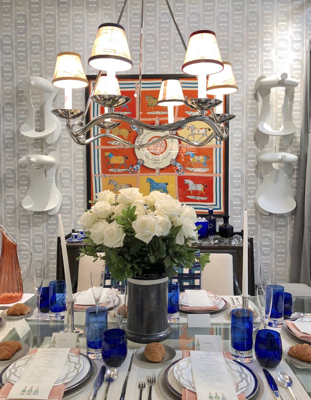 Orange and cobalt blue color scheme used in equestrian themed dining room, designed by Jonathan Savage.
