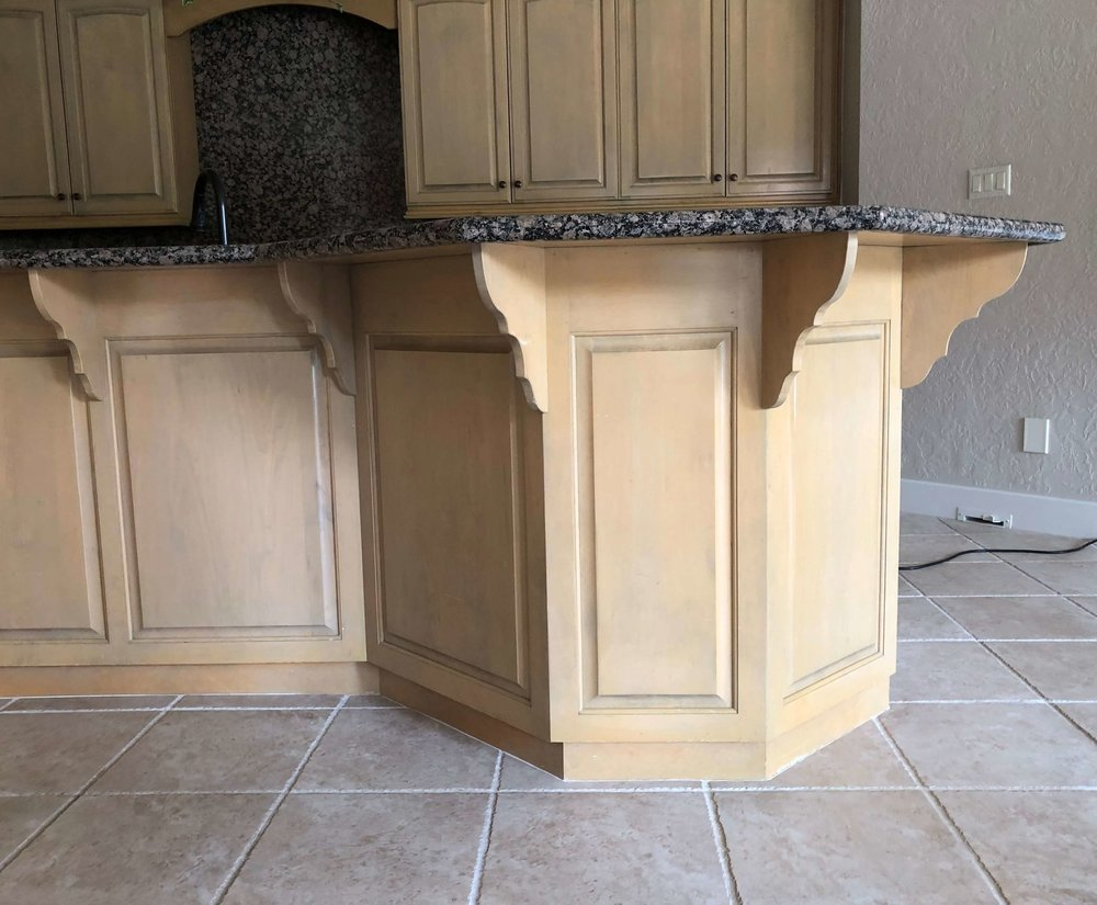BEFORE REMODEL - Wonky kitchen island with dated brackets, overall convoluted shape and spotty, Baltic Brown granite #kitchenisland #kitchenremodel