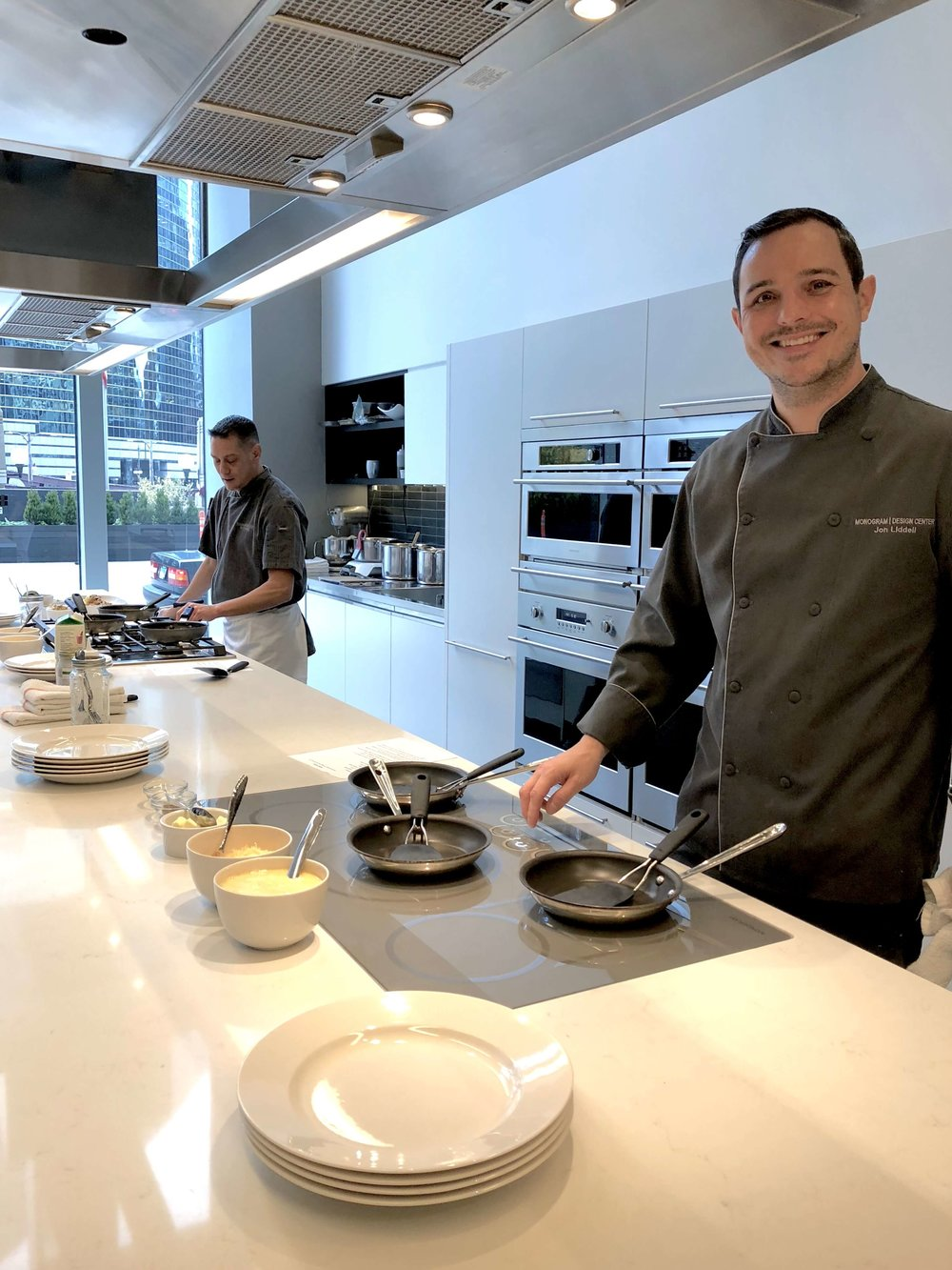Chef Jon at the Chicago Monogram Appliances showroom, demonstrating how to improve your cooking skills using these luxury kitchen appliances. #monogramappliances #inductioncooking #kitchendesigner #kitchendesign