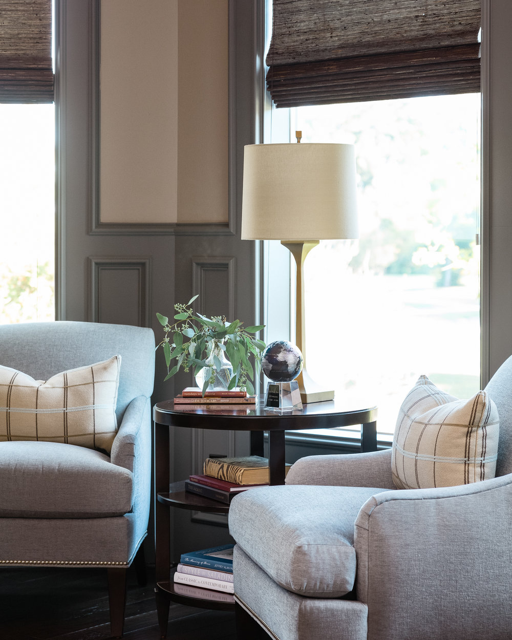 Home office  with gray paneling, seating and beige, warm accents |  Designed by Carla Aston,