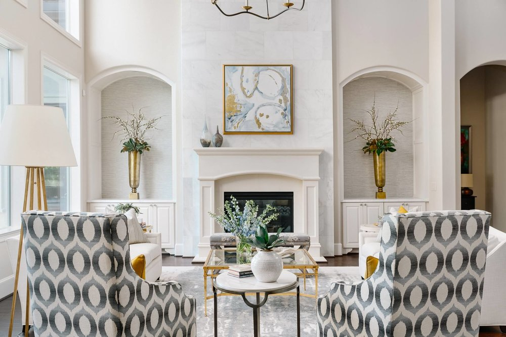 Lovely living room with white marble clad fireplace | Designer: Carla Aston, Contractor: Shaun Bain, Photographer: Colleen Scott #living room #livingroomideas #marblefireplace #niches