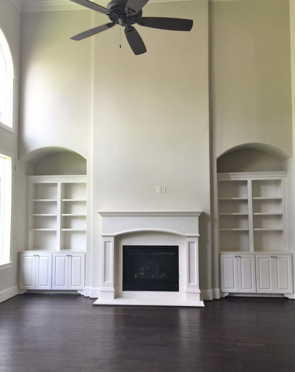 BEFORE - A light filled beautiful space that lacked the quality of materials this living room deserved. #livingroomideas #marbletile #fireplacewall #niche