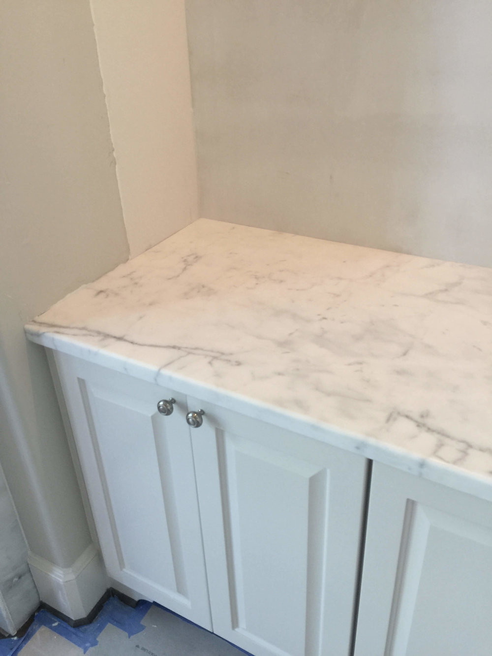 IN PROGRESS - New marble counters were added in the niche built-in cabinets #whitemarble #cabinetry #niche #countertop