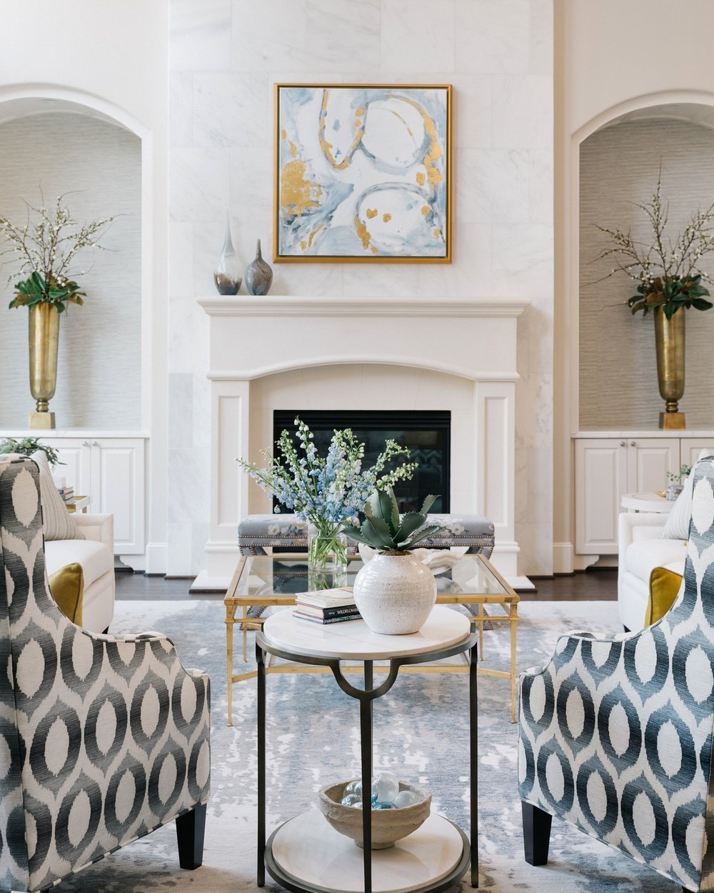 Lovely living room with white marble clad fireplace | Designer: Carla Aston, Contractor: Shaun Bain, Photographer: Colleen Scott #livingroom #livingroomideas #marblefireplace #niches
