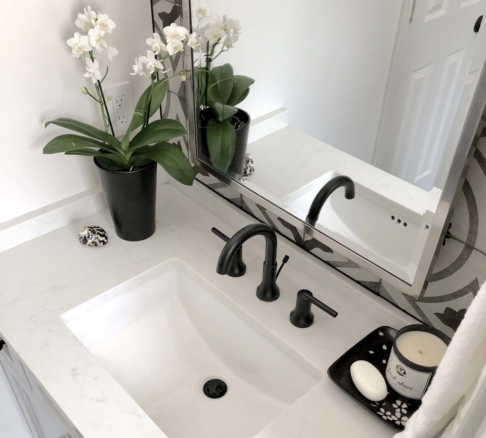 Black faucet in bathroom remodel | Carla Aston, Designer | Charles Behrend, Photographer #bathroomremodel #blackfaucet