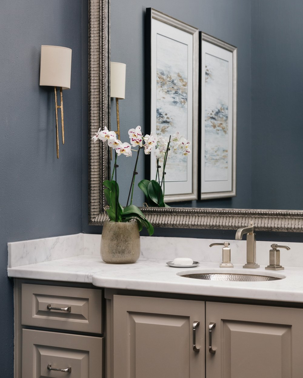 POWDER BATH ROUND UP | white marble counter with hammered nickel sink and slate blue walls | Carla Aston, Designer | Colleen Scott, Photographer #powderroom #powderbath