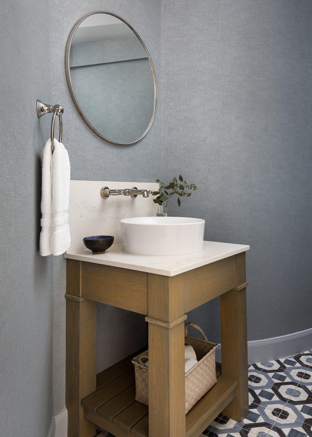 POWDER BATH ROUND UP |blue powder bath with porcelain concrete look tile floor, quartz countertop, chunky vessel sink, wall mount faucet | Designer: Carla Aston, Photographer: Colleen Scott | #powderbath #powderroom