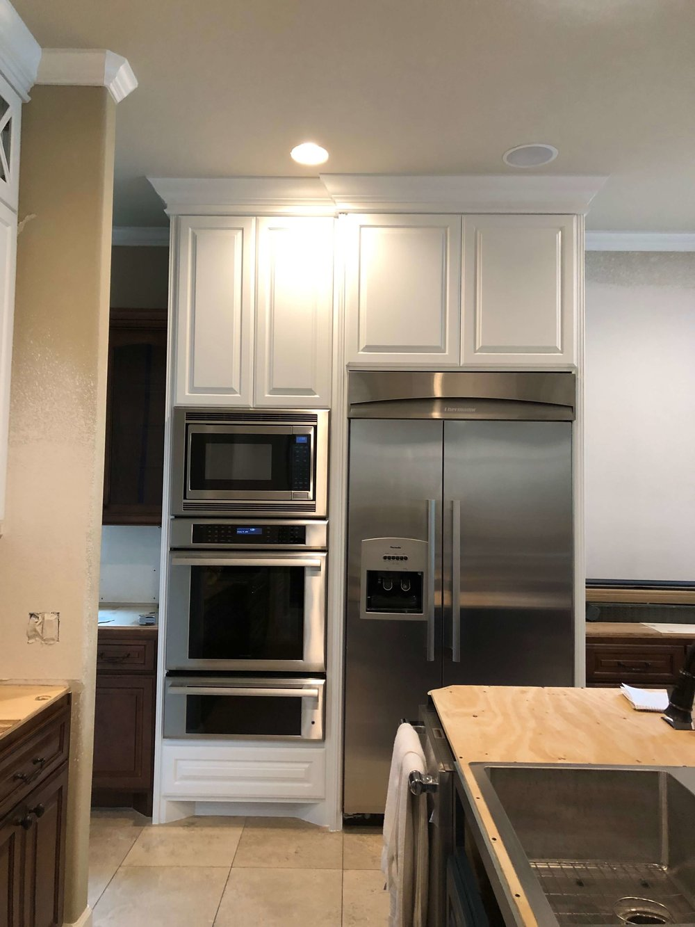 What To Upgrade In Your New Builder Home And What NOT To | Image: During Construction - Cabinets to the ceiling render a lot more extra storage and visual height to the space