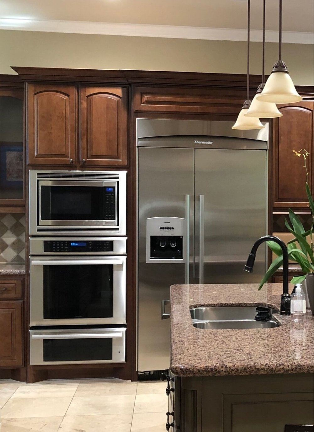 What To Upgrade In Your New Builder Home And What NOT To | Image: Before Remodel - Cabinets above the fridge stored nothing!